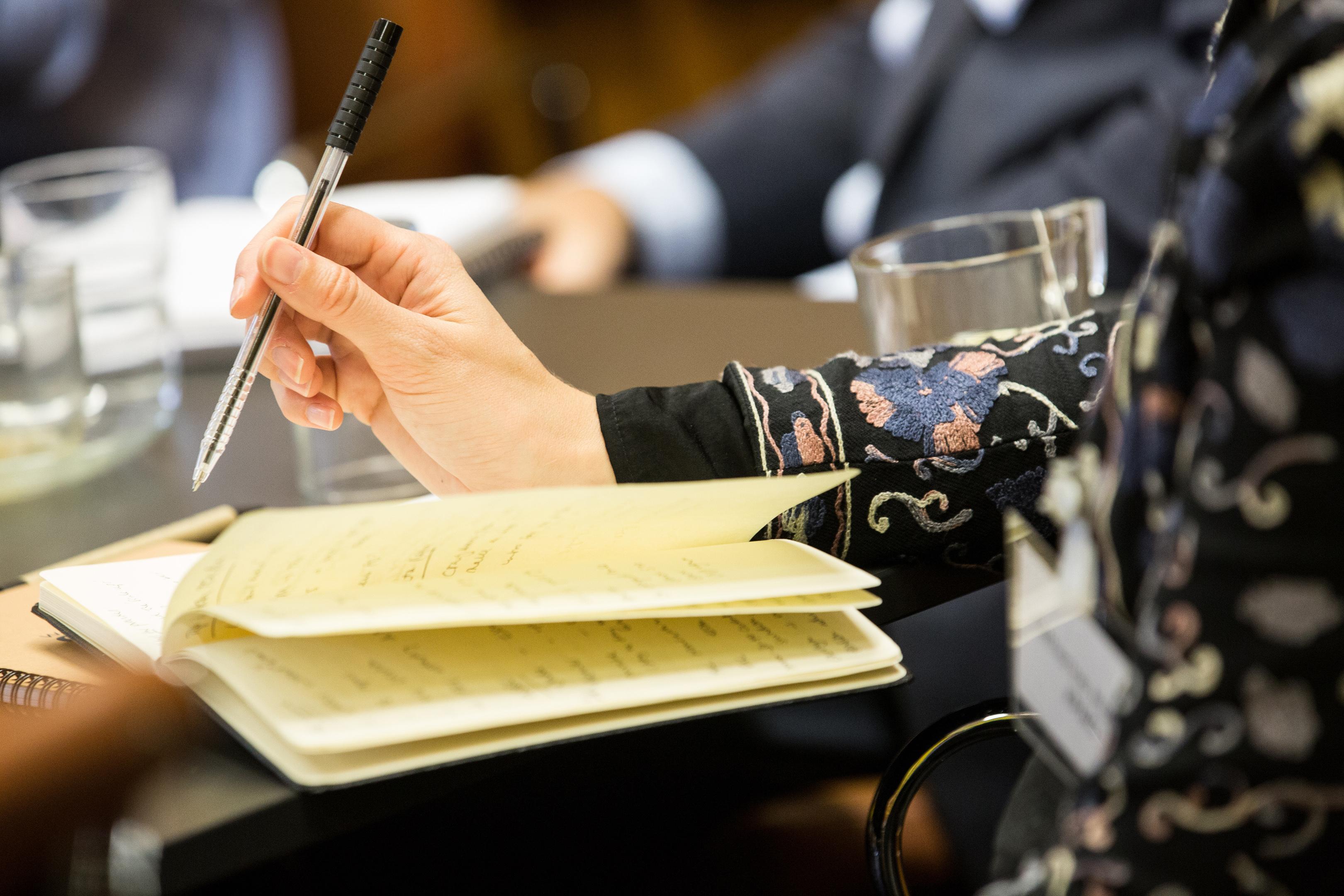 Women taking notes