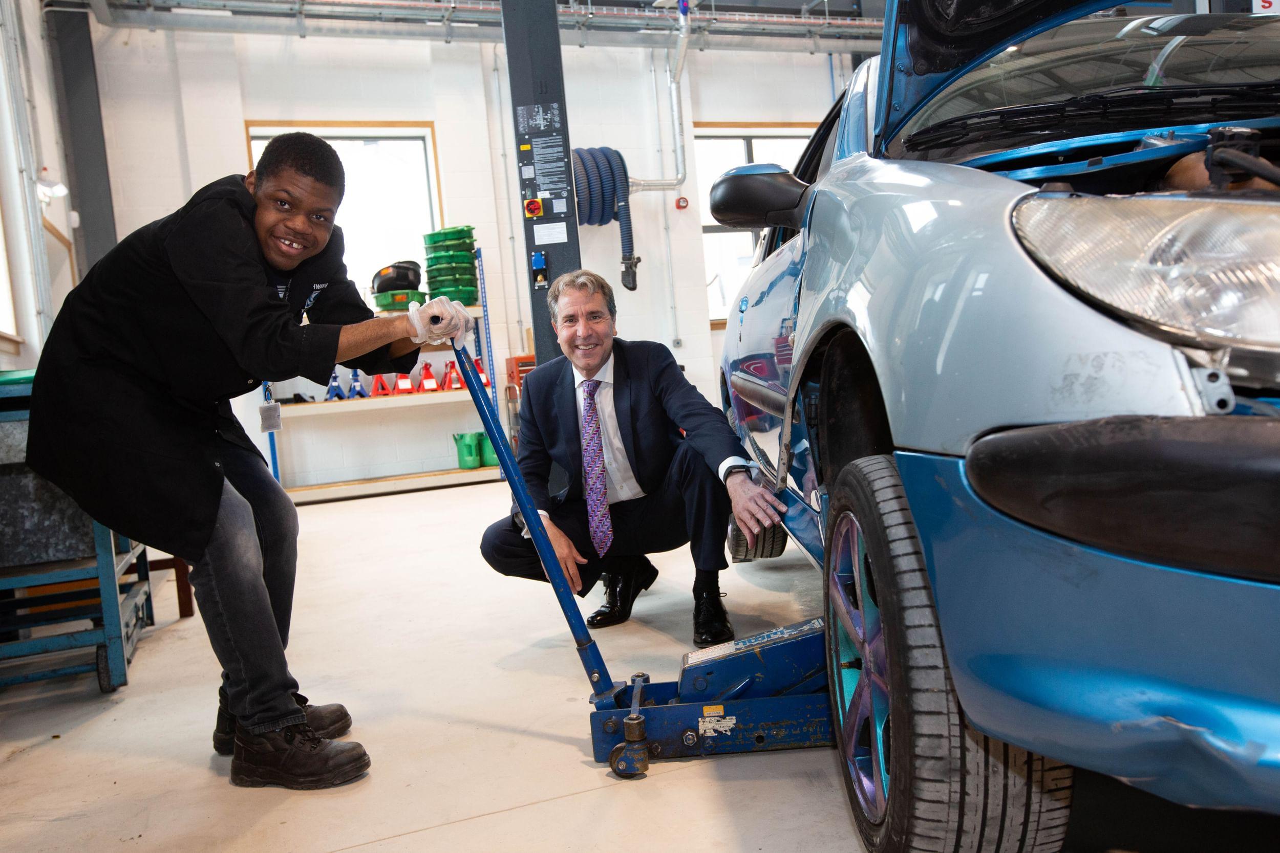 Metro Mayor Dan Norris at a car workshop