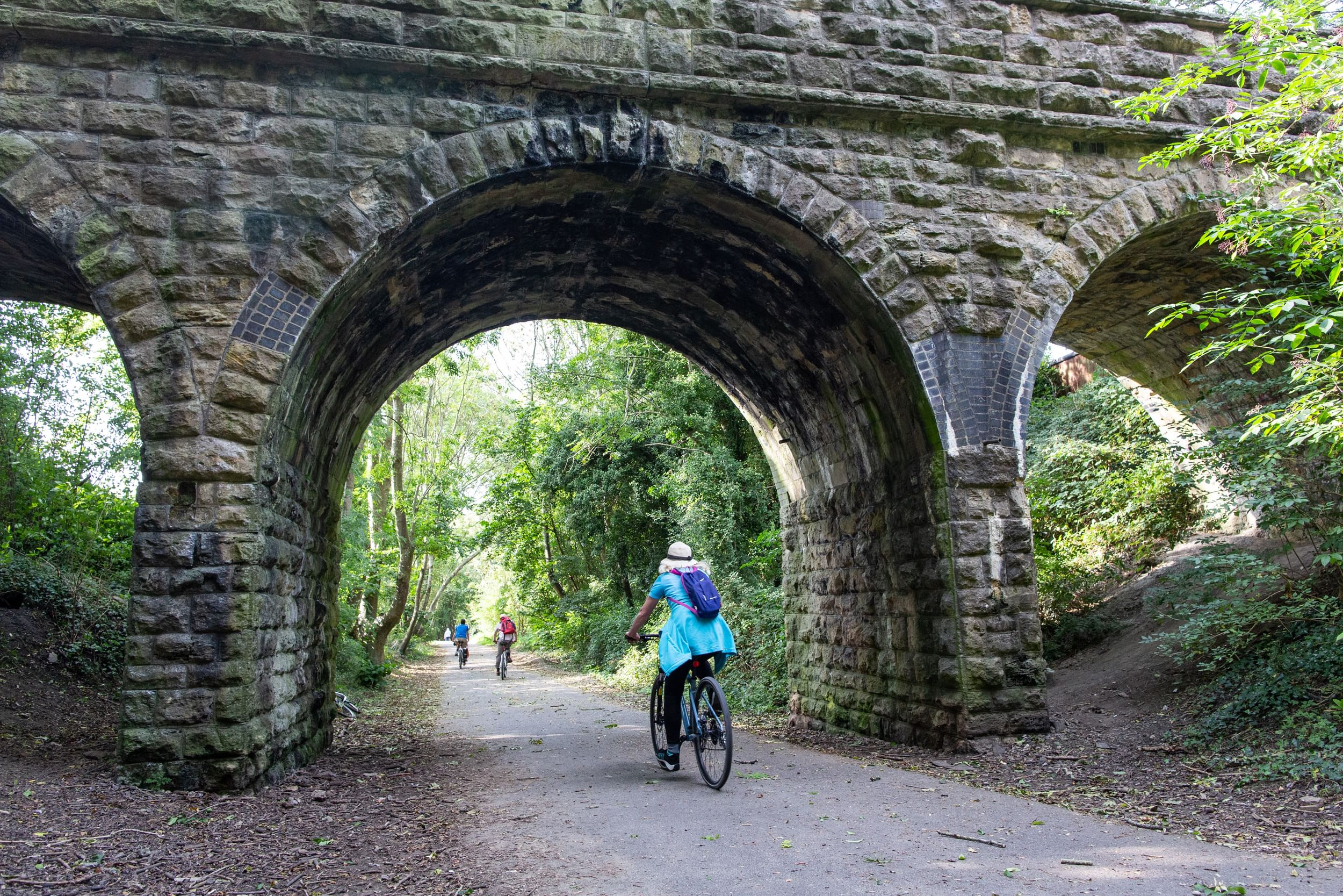 Cyclist under a bridge