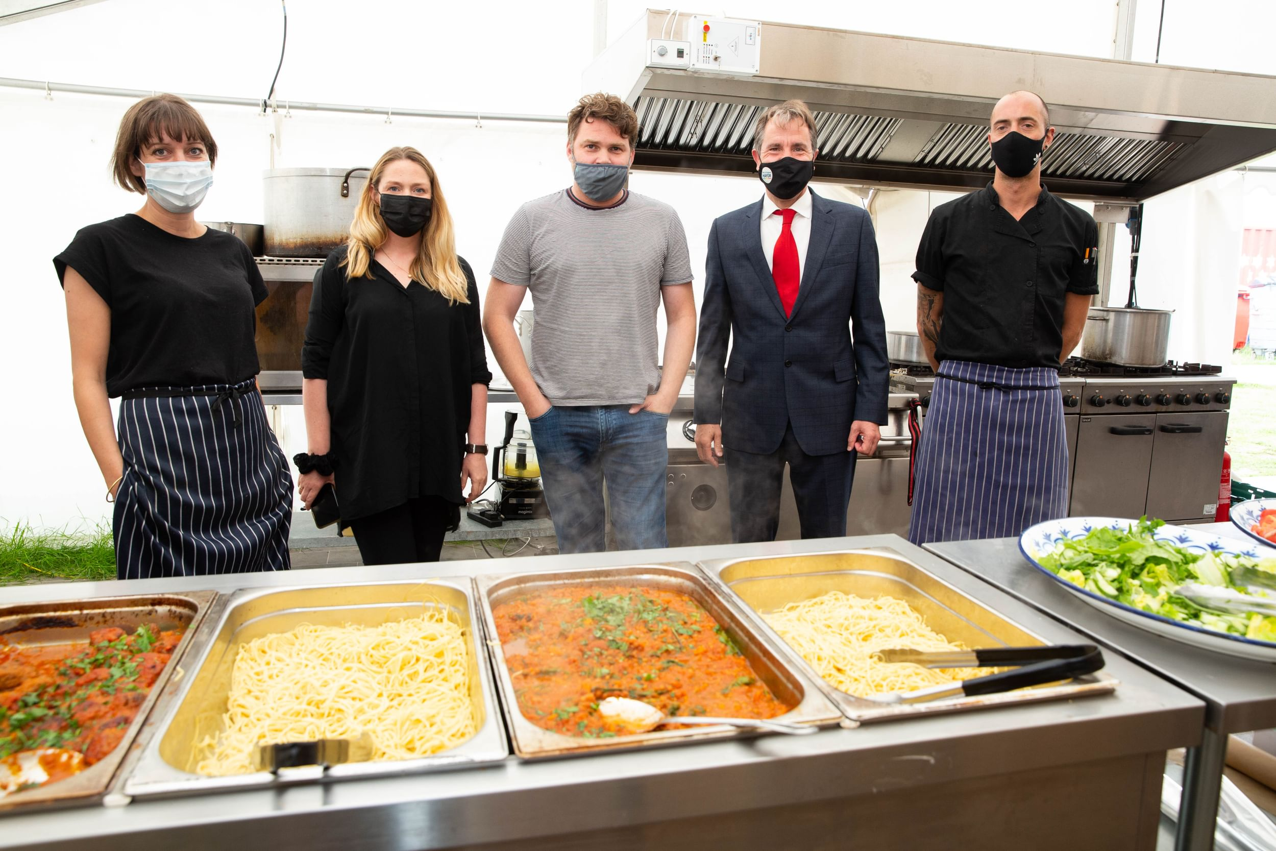 Metro Mayor with others in a kitchen