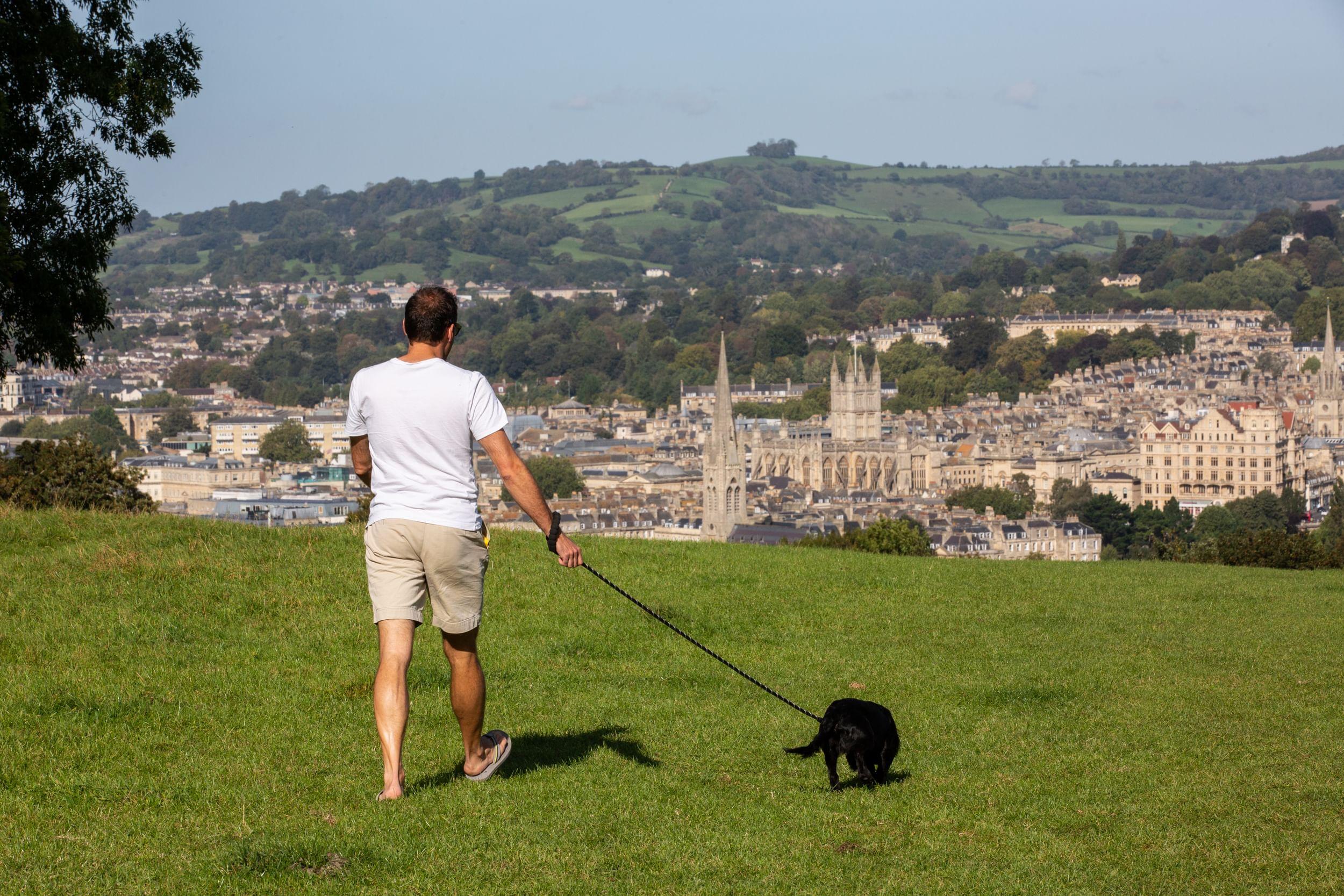 Man walking his dog in Bath