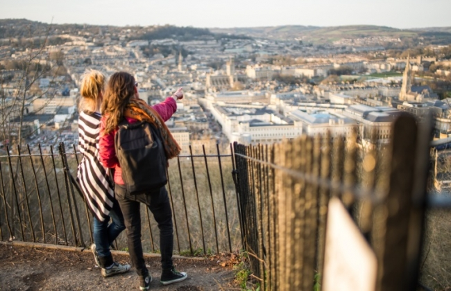 Two girls looking over the city of Bath