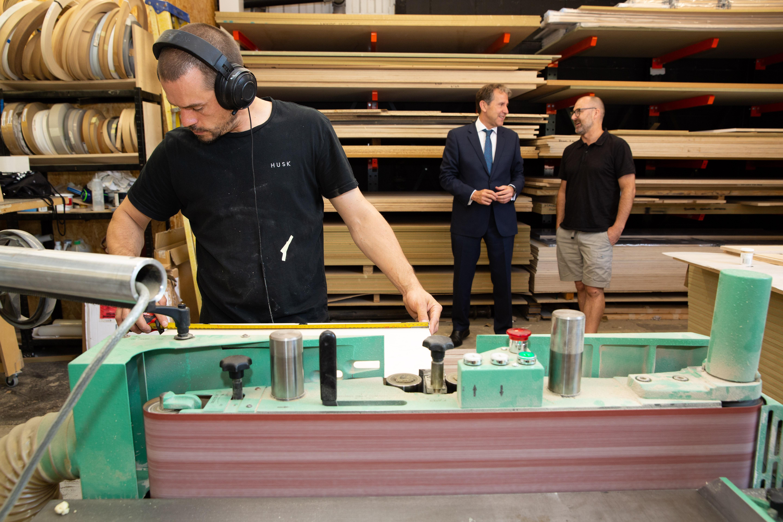Apprentice using machinery