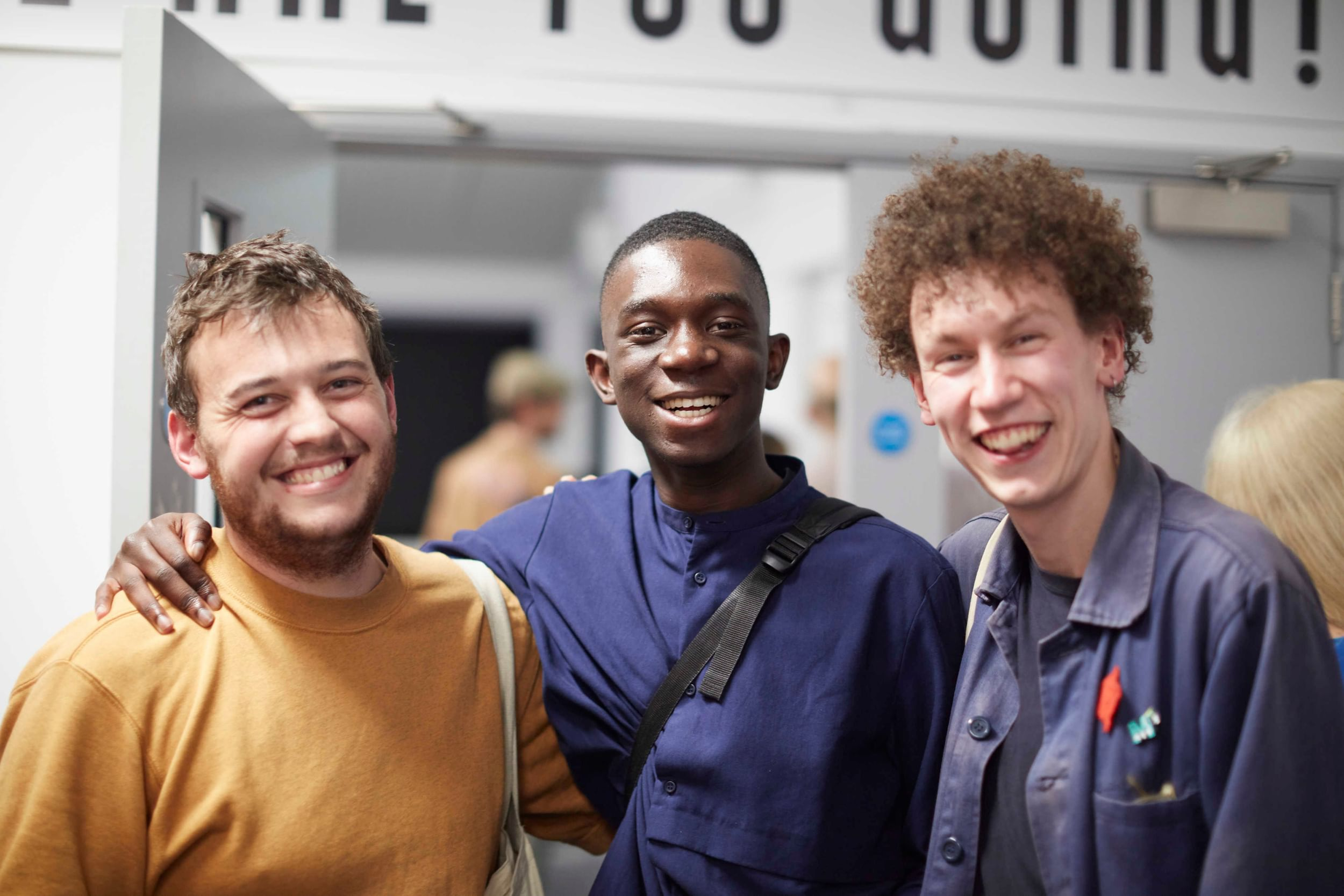 Group of three students smiling