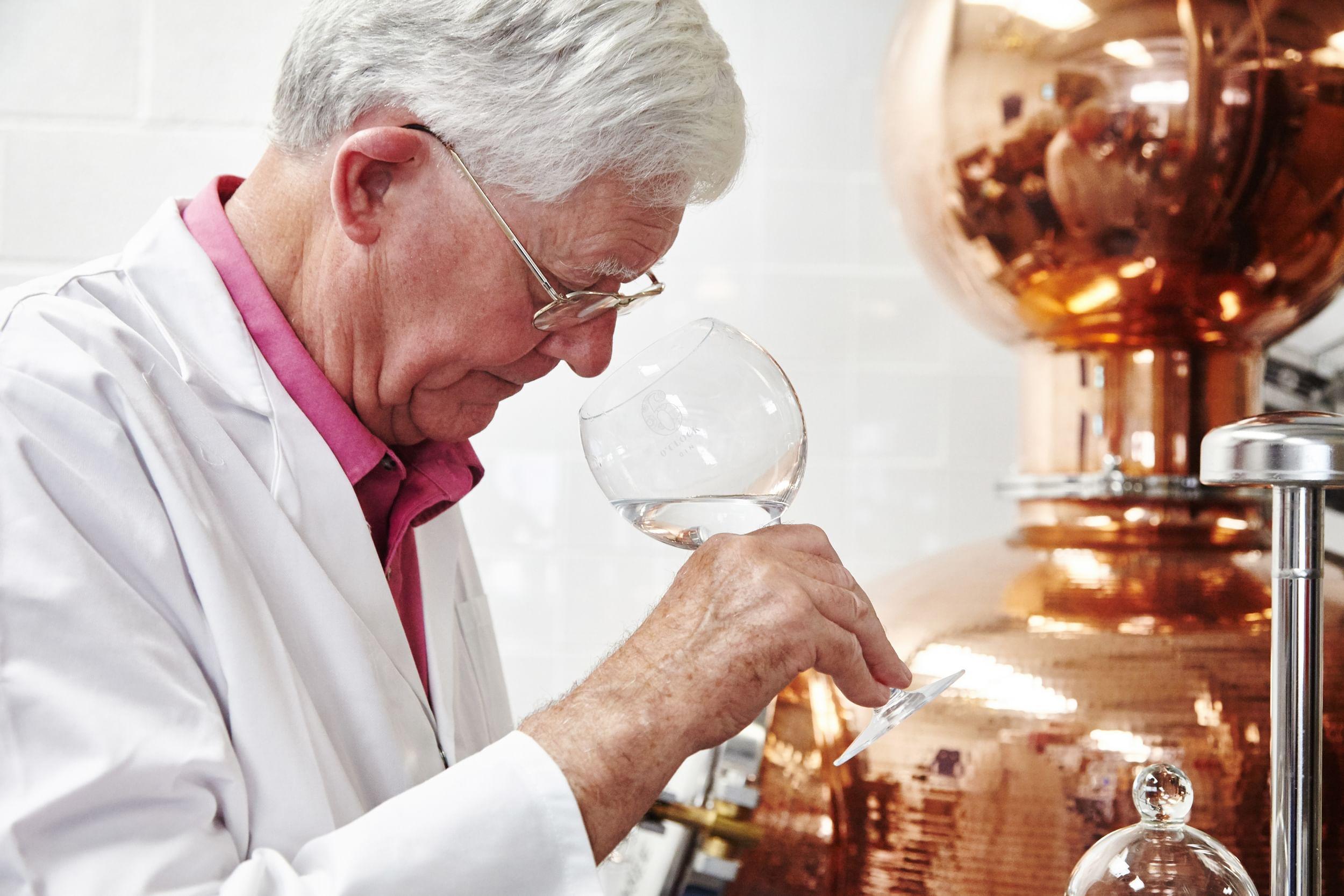 Man taste testing gin