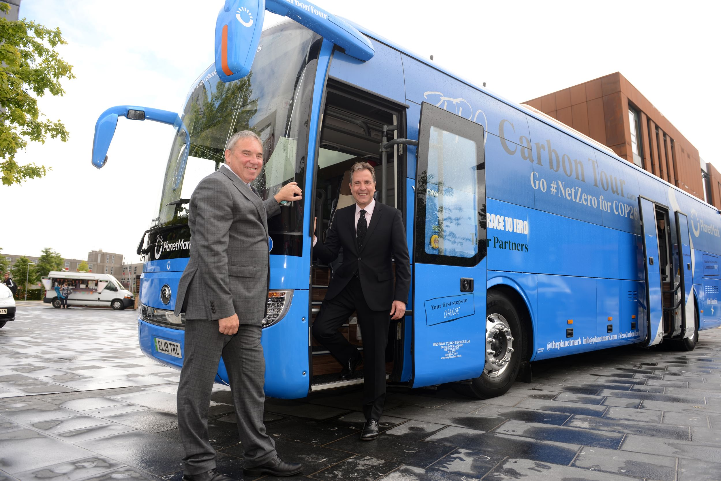 Metro Mayor Dan Norris with a blue Carbon bus