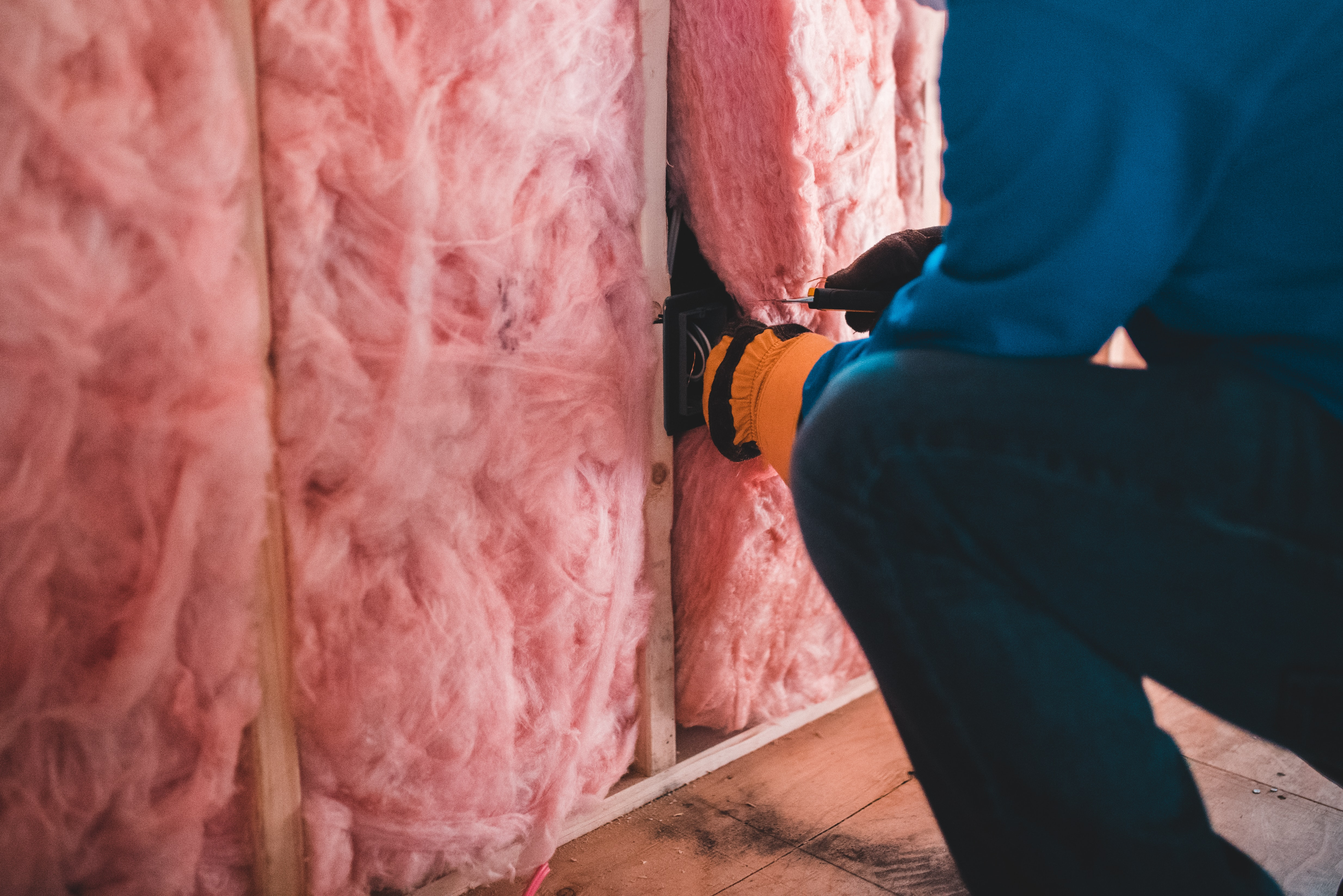 Person installing insulation